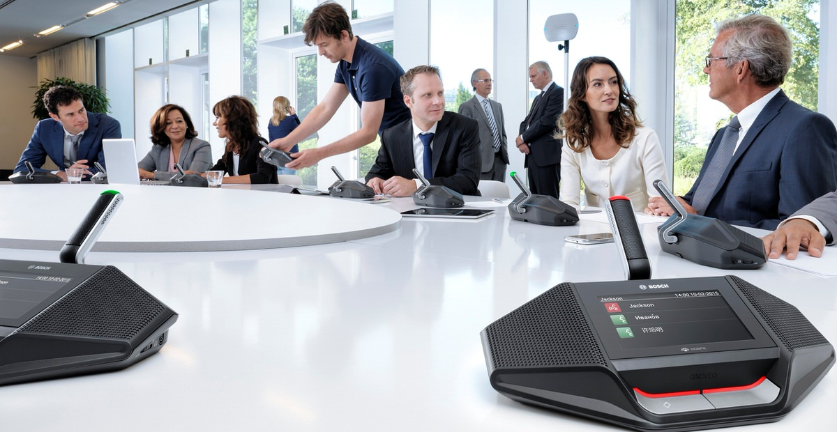 hero image of Dicentis wireless sytem set up in conference room with various people enjoying its use.