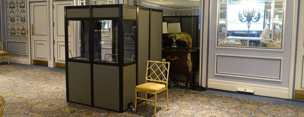 an interpreter booth in a fancy looking meeting room