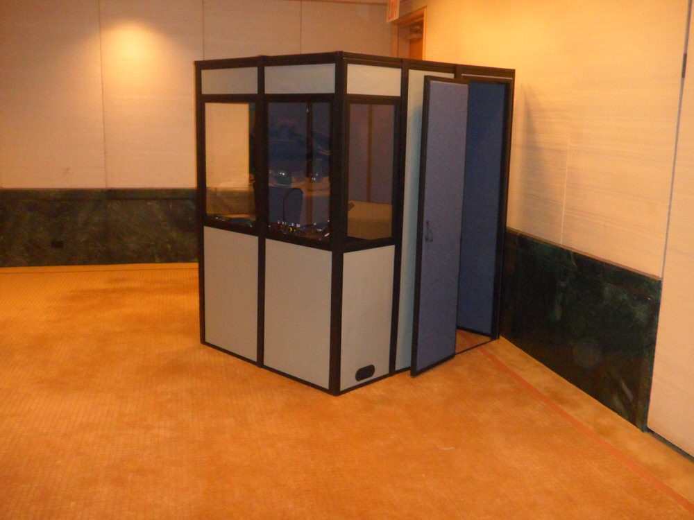 an interpreter booth that is fully enclosed